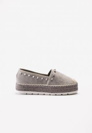 Oblique espadrille sneaker with pyramid studs and rope trim detail on sidewall.