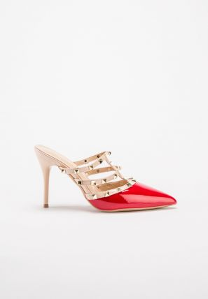 Valentino's iconic pyramid studs punctuate the strappy faux leather mule
